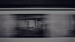 Trying to focus on a poster from a moving train